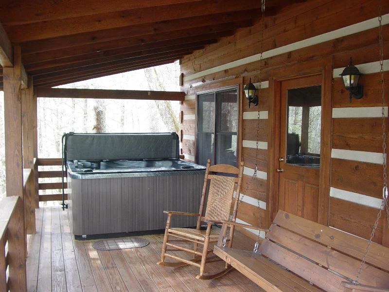 Covered Porch with Hot Tub, Rocking Chairs & Swing