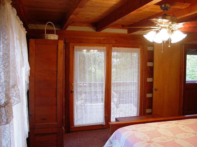 Downstairs Master Bedroom - Queen Size Bed - French Doors Leading to Covered Porch with Hot Tub
