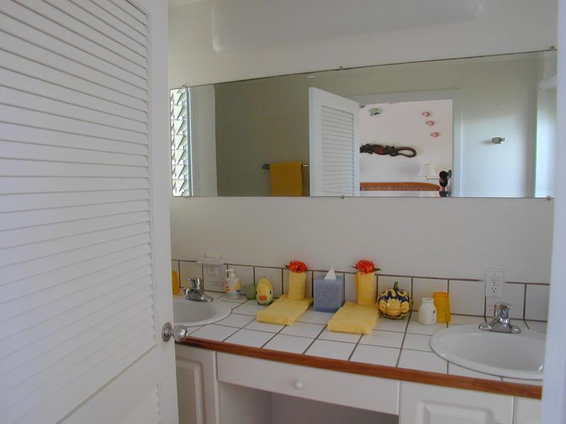 bedroom bathrooms each have double sink vanities with oversized mirrors
