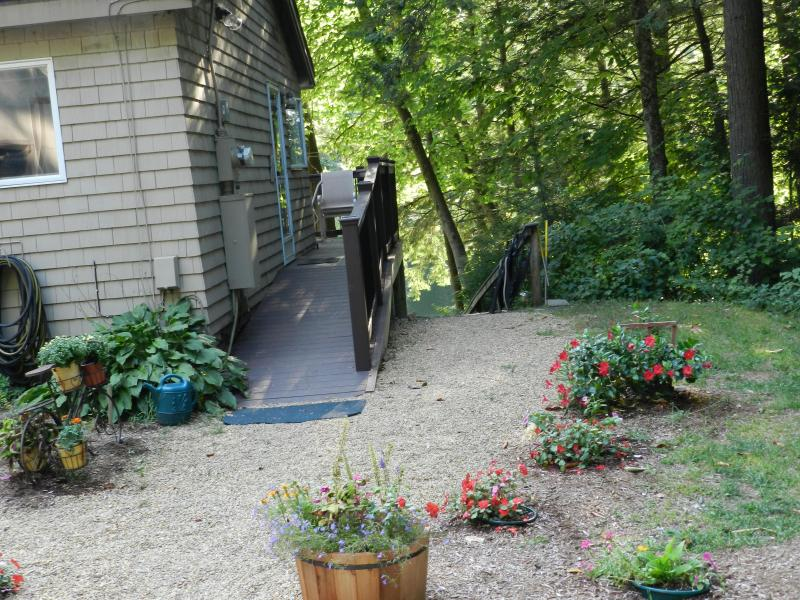 Side ADA entrance to deck and LR.  Stairs to patio & dock is to the right.