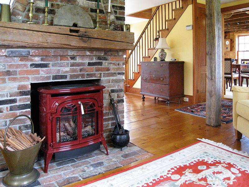 Haven Homeplace Living Room and the Red Decorative Propane Stove (non-functioning)