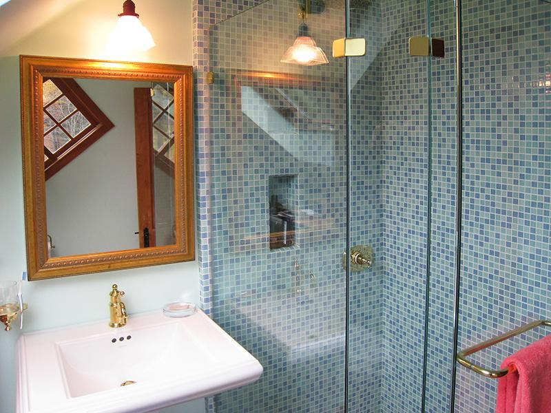 Fully updated Bathroom with Pedestal Sink and Frameless Glass Shower