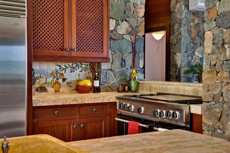 Sub Zero Refrigertor, Bluestar Range, 4' Thick Travertine Counters, Custom Mahogany Cabinetry