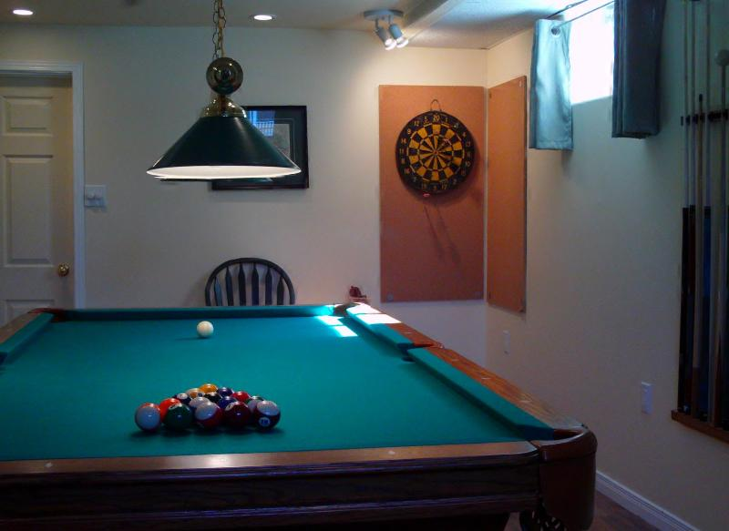 lower level pool table with ball attached to cue for young players