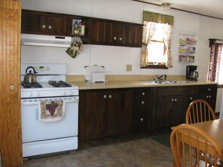 Eat-in kitchen has propane cook stove & oven, full size fridge, microwave, toaster, coffee machine.