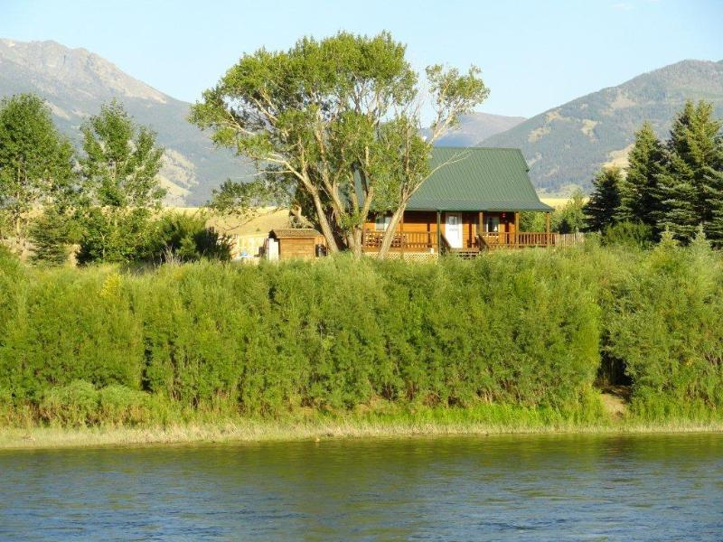Yellowstone Lookout Log Cabin from across the Yellowstone River