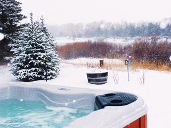 The inviting hot tub in the winter!