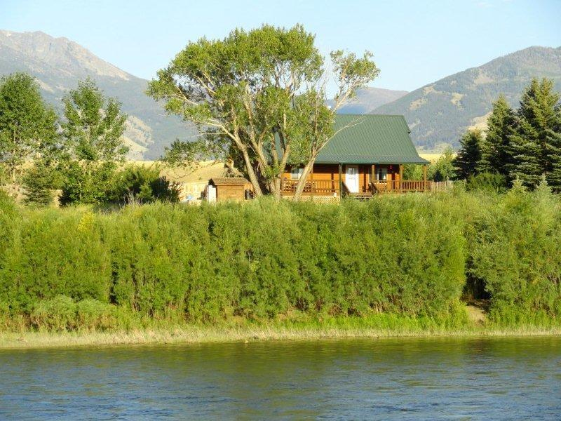 The Log Home from across the River