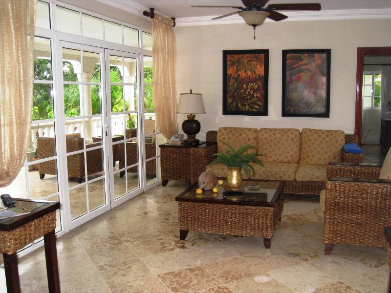 Living area of one of the villas; French doors leading to patio and pool
