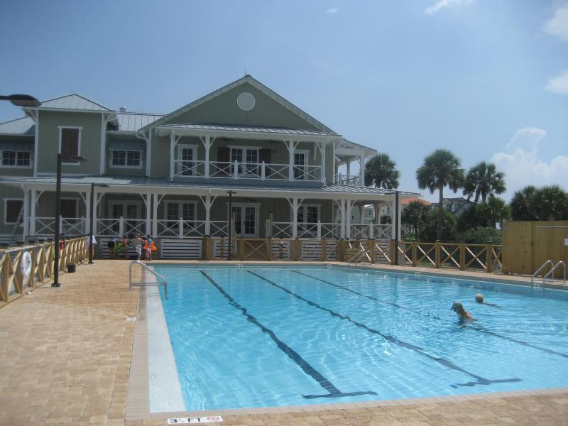 Community Pool with lots of seating, tables, umbrellas and plenty of parking and bike racks.