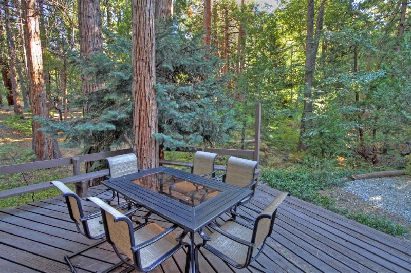 Enjoy eating outdoors on the front deck at Idyllcreek.