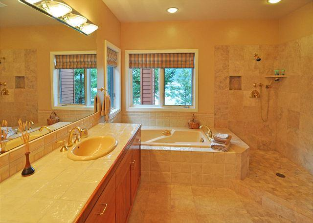 The master bath is spacious, well equipped and includes a large soaking tub and shower.