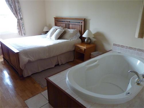 Air massage tub in master bedroom