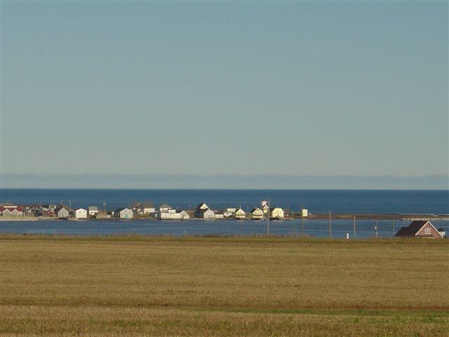 Rustico Harbour. Only three kms away if you could walk on water.