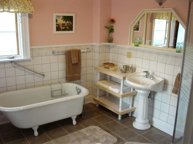 Large bathroom with claw foot tub and shower