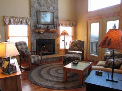 Cozy living room with gas log fireplace and a wonderful view!