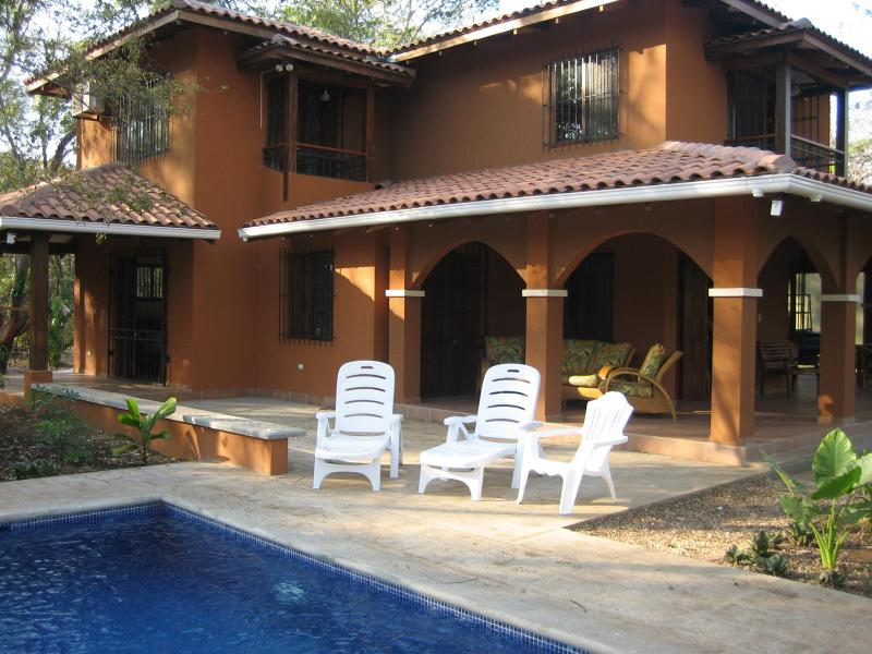 Lap pool, patio and wrap-around terrace