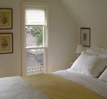 This peaceful bedroom overlooks the shaded rear garden.