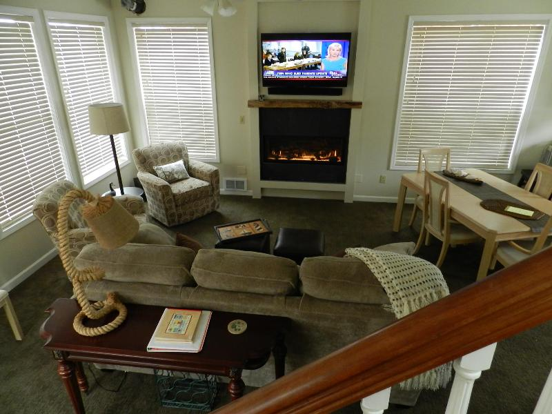 cozy living room with gas fireplace and large screen TV