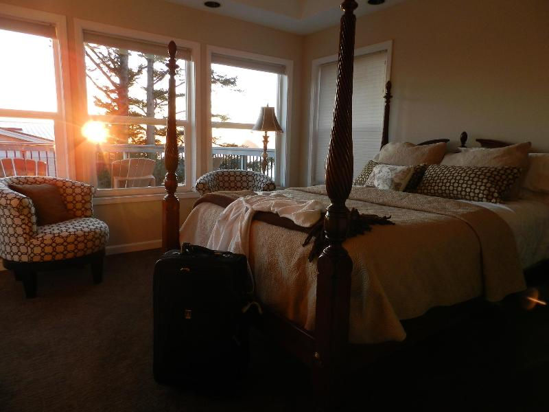 Master bedroom with outstanding view, large deck, jacuzzi tub, reading chairs by view