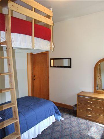bunk bed room with 1/2 bathroom