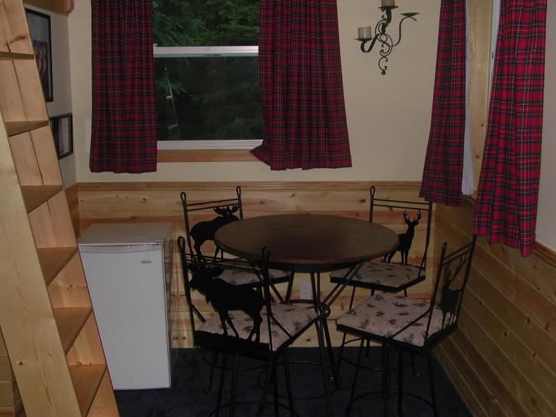 Table for 4 and refrigerator with walk in closet
