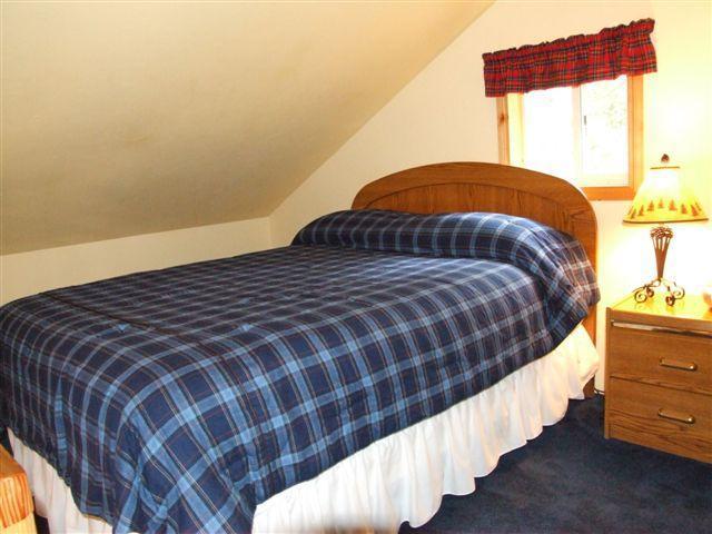 Queen bedroom in loft of Cabin