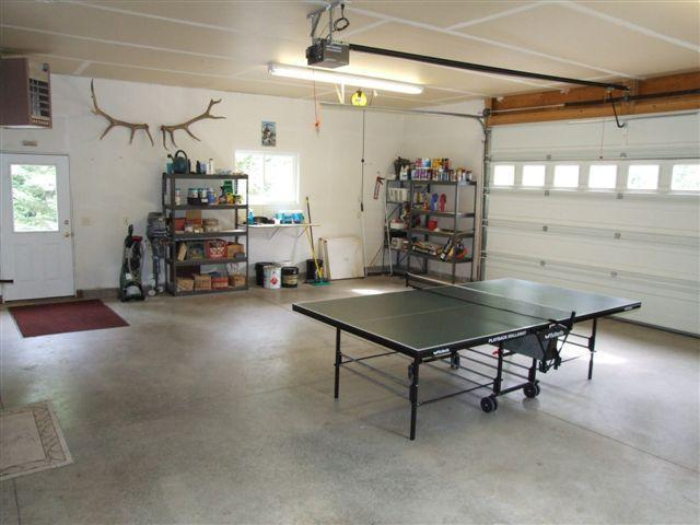 heated garage with doggy door and ping pong table