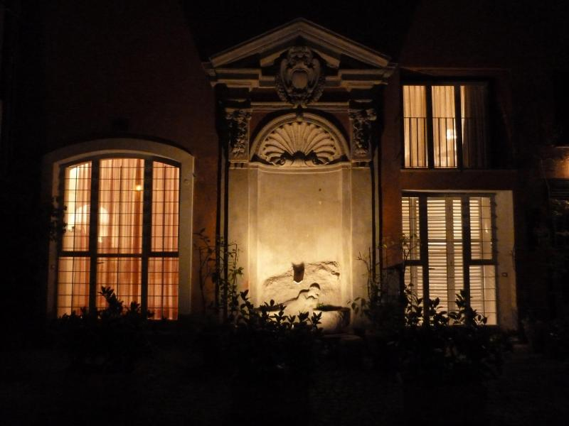 Property view at night from courtyard