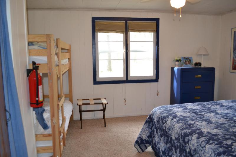 Master bedroom has bunk beds