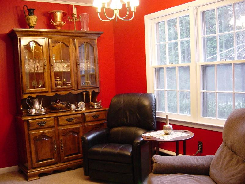 Red room opens up to the fireplace and dining area