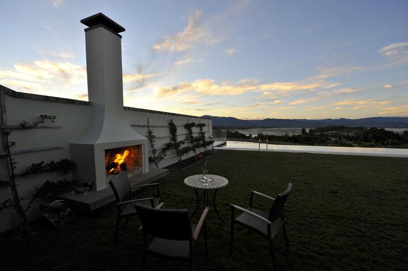 Outdoor fireplace in front of Studio
