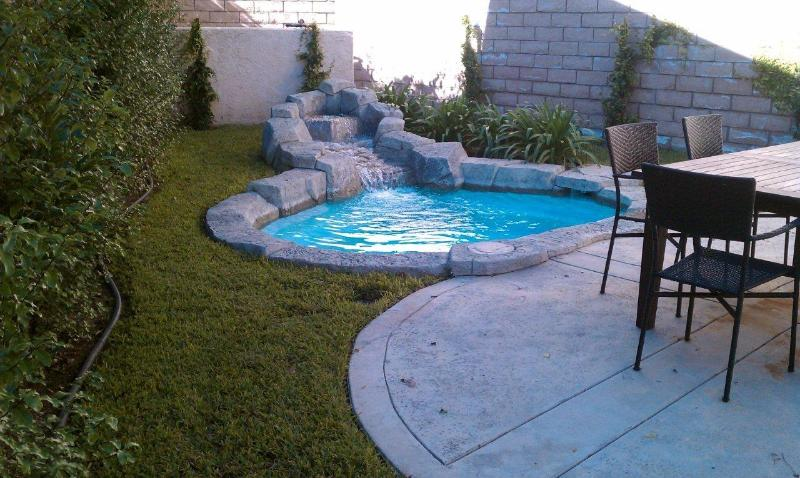 Built in Spa in our Private Backyard with Outdoor Dining Table and Barbeque.