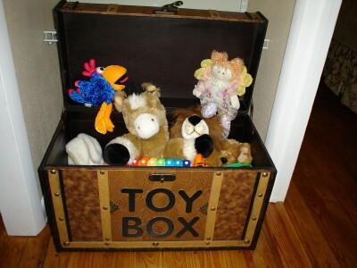 Kids have fun discovering the Toy Box full of stuffed critters; also available: toys, games & books