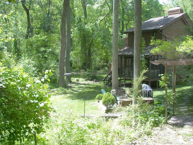 Back of Joy Chalet and Lush Back Yard backs up to 30 acre Woodlands