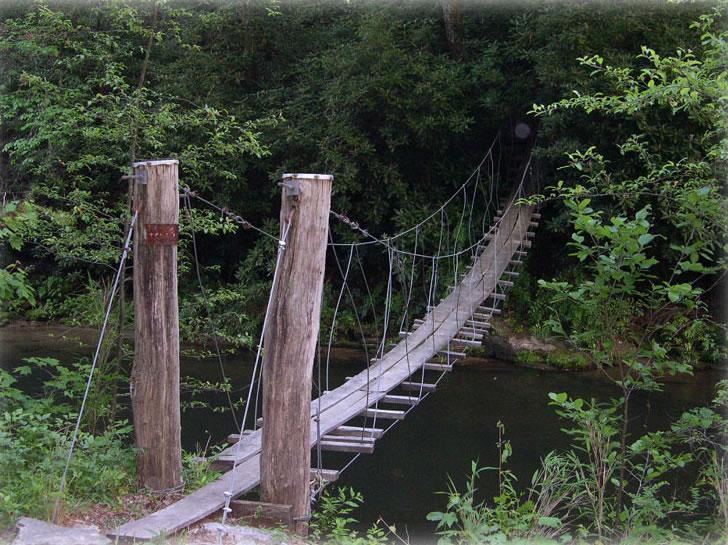 SWINGING WOODEN BRIDGE