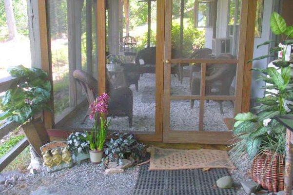 Entrance to screened in porch of apartment