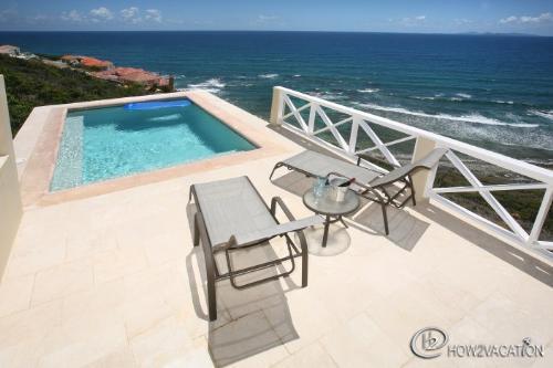 Caribella...St Maarten Villa...Piscina / Deck con vista al mar
