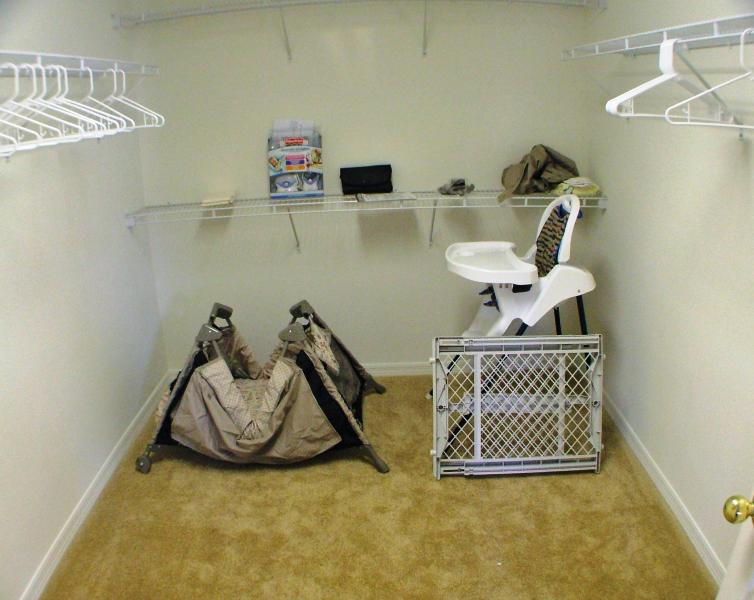 Grand king master dressing room with travel cot, stair gate, high chair and baby monitor