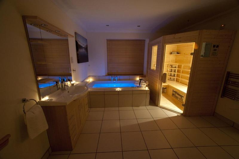 Sauna and Spa Bathroom with hot tub