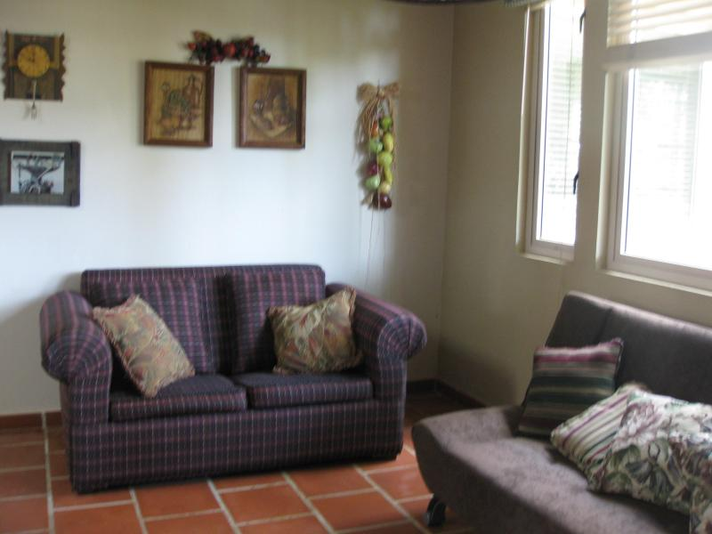 Sitting area near kitchen- extra sofa bed in this spacious villa of over 3200 square feet!