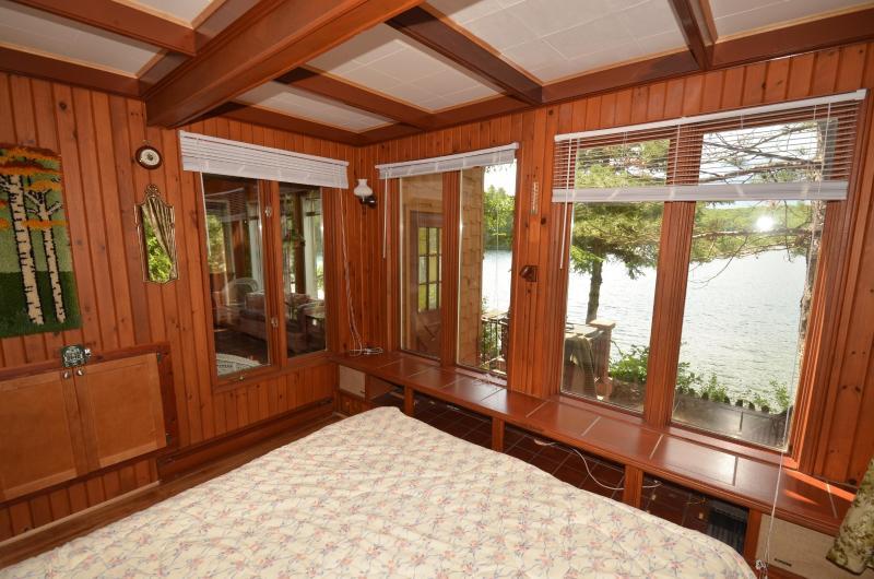 1st bedroom featuring queen bed