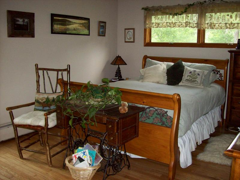 master bedroom in upper level of B&B, queen bed, private bath, private deck, $95 per night w/breakfast