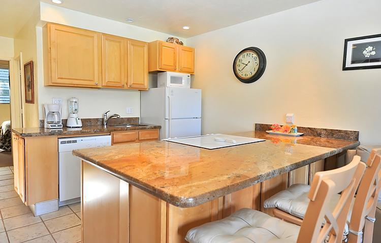 Fully equiped kitchen with granite counter tops and built in appliances