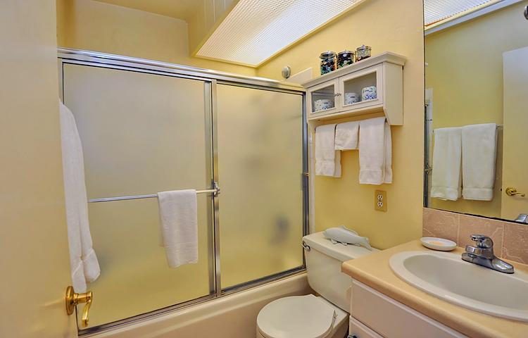 Bath adjacent to bedroom 2