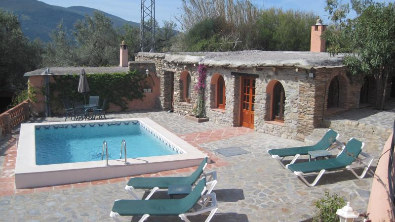 Jasmin Cottage and swimming pool overlooking the orchard with the mountains beyond