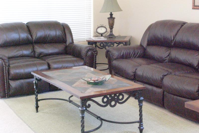Living room with recliner leather furniture.