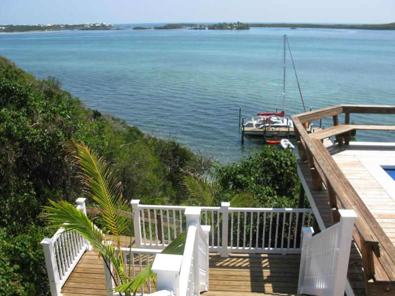 View from deck. Pool area to the right and stairs down to the dock toward left
