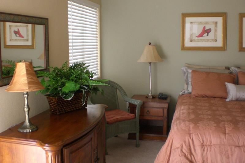 Master bedroom, door to the private yard/ pool/ spa, master bathroom ensuite, large walk in closet.