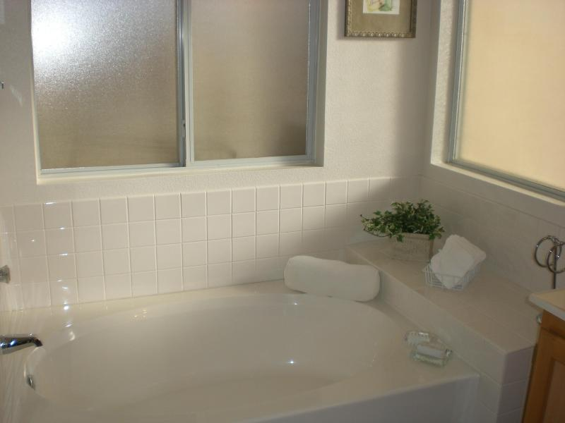 Large bright bathroom with soaking tub to relax